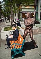 "Saleryman sitting on a bench about to be ""assulted"" by famous Baseball player Matsui ""Godzilla""."