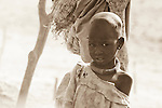 "A girl grows up in a dusty cattle camp near Rumbek, South Sudan.  The Dinka are traditionally ""cattle keepers,"" living in cattle camps with hundreds or even thousands of cows."
