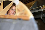 Garden City, New York, USA. July 8, 2012. Volunteer Kathleen W helps recreate wing of historic aircraft for Danish government at Cradle of Aviation air hanger