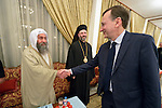 Peter Prove (right) director of international affairs for the World Council of Churches, greets Tarmeda Nadam Kreadi, a leader of the Sabaean-Mandean religious community in Iraq, during the visit of an international ecumenical delegation to Baghdad, Iraq, on January 21, 2017. The encounter took place at St Gregory the Illuminator Armenian Orthodox Church. Looking on is Ghattas Hazim, the Greek Orthodox Metropolitan of Baghdad, Kuwait and Dependencies.