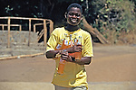Local Boy On Nkhata Bay Beach Selling Fanta