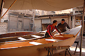 IRAQ, MOSUL:  Two men build a traditional fishing boat in the Medan neighborhood of Mosul....Photo by Bashar Adnan/Metrography