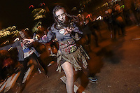 "A woman reenacts dance of zombies from Michael Jackson's ""Thriller"" during the 41st Annual Halloween Parade. 10.31.2014. Photo by Marco Aurelio/VIEWpress"