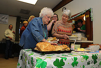 NWA Democrat-Gazette/FLIP PUTTHOFF <br /> ST. PATS AT ST. ANDREWS<br /> Pat Fryauf (foreground left) and Shirley Sutton sample Irish breads during the annual St. Patrick's Day dinner Saturday March 12, 2016 at St. Andrew's Episcopal Church in Rogers. The church men's group cooks the main course of corned beef and cabbage and women of the church bring desserts. The St. Patrick's Day meal has been a tradition at the church for years, the cooks said.