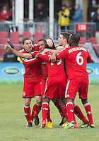 06 April 2013: Toronto FC players celebrate the equalizing goal by Toronto FC midfielder Darel Russell #16 during an MLS game between FC Dallas and Toronto FC at BMO Field in Toronto, Ontario Canada..The game ended in a 2-2 draw..