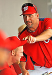 7 March 2012: Washington Nationals Spring Training Instructor Paul Menhart adjusts Stephen Strasburg's cap during a game against the St. Louis Cardinals at Space Coast Stadium in Viera, Florida. The teams battled to a 3-3 tie in Grapefruit League Spring Training action. Mandatory Credit: Ed Wolfstein Photo