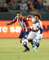 Chivas forward Alan Gordon (16) battles Revolution defender Kevin Alston (30) during the second half of the game between Chivas USA and the New England Revolution at the Home Depot Center in Carson, CA, on September 10, 2010. Chivas USA 2, New England Revolution 0.