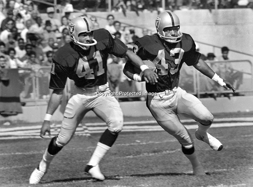 Oakland Raiders Alvin Wyatt and George Atkinson return..(1970 photo/Ron Riesterer)