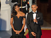 United States President Barack Obama flashes a thumbs-up as he and First Lady Michelle Obama await the arrival of President XI Jinping of China and Madame Peng Liyuan to a State Dinner in their honor on the North Portico of the White House in Washington, DC on Friday, September 25, 2015.<br /> Credit: Ron Sachs / CNP