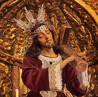 Statue of Christ wearing the crown of thorns and carrying the Cross, in the the Jesuit Church of Saints Justus and Pastor of Alcala, built 1575 on the site of a mosque in Granada, Andalusia, Southern Spain. Saints Justus and Pastor were 4th century schoolboy christian martyrs, who were killed for their faith under the persecution of the christians by the Roman emperor Diocletian. Granada was listed as a UNESCO World Heritage Site in 1984. Picture by Manuel Cohen
