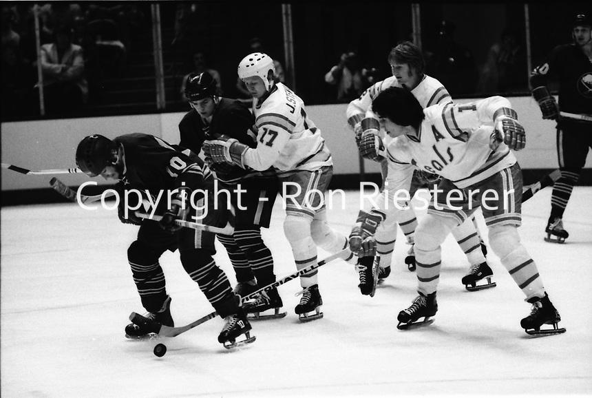 California Golden Seals vs Buffalo Sabres, #17 John Stewart and #15 Jim Neilson.<br />(photo by Ron Riesterer)