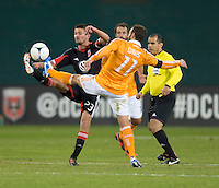 Perry Kitchen (23) of D.C. United fights for the ball with Brad Davis (11) of Houston Dynamo during the game at RFK Stadium in Washington,DC. D.C. United tied the Houston Dynamo, 1-1.  With the tie, Houston won the Eastern Conference and advanced to the MLS Cup.
