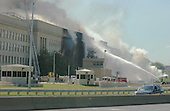 Washington, DC - September 11, 2001 -- Firefighters pour water on the Pentagon where the terrorist attack occured in Washington, D.C. on Tuesday, September 11, 2001..Credit: Ron Sachs / CNP.