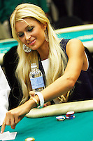 3 March 2007: Celebrity Paris Hilton drinks a bottle of water while playing a poker hand in action  during the fifth annual WPT Invitational at the Commerce Casino in Los Angeles, CA.
