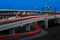 """Traffic light trails line the """"Spaghetti Highway"""" Mopac exchange in northwest Austin, connects Highway 183, Mopac Loop 1 and Loop 360, the Capital of Texas Highway."""