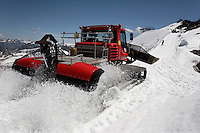 Machinery clears the way for workers on Brunnenkogel Ferner.  It is being wrapped with a fleece-like cover to keep it from melting.  Covered ice melts slower. <br /> The ski area at 3,400 meters is covered to help save the ski industry since the glacier is retreating.  The cost of materials is one Euro per square meter.<br /> <br /> The Alpine glaciers -- in Austria, Switzerland, France and Italy -- are losing one percent of their mass every year and, even supposing no acceleration in that rate, will have all but disappeared by the end of the century. More hot, dry summers like that of 2003 in Europe, when the loss speeded to five percent, could cut the life expectancy to no more than 50 years, according to Wilfried Haeberli of the University of Zurich...&quot;We estimate that by the end of the 21st century, with a medium-type climate scenario, about five percent of what existed in the 1970s will have survived, he added.