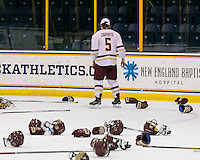 North Andover, Massachusetts - March 6, 2016: NCAA Division I, Women's Hockey East final. Boston College (white/maroon) defeated Boston University (red), 5-0, at Lawler Arena at Merrimack College. Boston College has a perfect Hockey East season - regular season, Bean Pot winner, and Women's Hockey East winner. Alex Carpenter retrieves gloves and stick, post Women's Hockey East celebration.