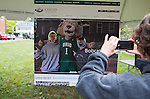 Kevin Rachman and Ian Stweart get their picture taken with Rufus on the new front page of the ohio.edu homepage on Oct. 9, 2014.