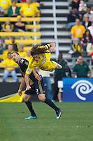 24 OCTOBER 2010:  Columbus Crew defender Frankie Hejduk (2) flies over Philadelphia Union defender Jordan Harvey (2) during MLS soccer game at Crew Stadium in Columbus, Ohio on August 28, 2010.