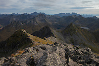 Rugged mountain landscape viewed from summit of Matmora mountain peak, Austvågøy, Lofoten Islands, Norway
