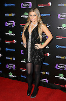 CARMEN ELECTRA .At SWAGG VIP Kid Rock Concert at the Joint inside the Hard Rock Hotel and Casino, Las Vegas, Nevada, USA,.7th January 2010..full length black sleeveless dress tights necklace platform shoes pearls beads hands on hips heels .CAP/ADM/MJT.© MJT/AdMedia/Capital Pictures.