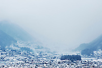 The edge of Matsumoto and the hills behind of a snowy winter's day, Nagano, Japan.<br />