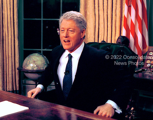 United States President Bill Clinton poses for photos after delivering his farewell address to the nation from the Oval Office of the White House in Washington, D.C. on January 18, 2001..Credit: Arnie Sachs / CNP