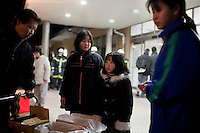 A child and her parents queue for water at an emergency evacuation center for victims of the recent earthquake and tsunami. On 11 March 2011 a magnitude 9 earthquake struck 130 km off the coast of Northern Japan causing a massive Tsunami that swept across the coast of Northern Honshu. The earthquake and tsunami caused extensive damage and loss of life and damaged Fukushima nuclear reactor. Two of the power station's reactors sustained extensive damage after explosions at the plant.