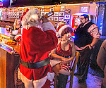 Santa and Mrs Clause enjoy the band and a cold beer at Veets in Mobile, Ala.