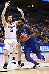 MILWAUKEE, WI - MARCH 18: Middle Tennessee Blue Raiders forward JaCorey Williams (22) draws a foul on the way to the basket during the first half of the 2017 NCAA Men's Basketball Tournament held at BMO Harris Bradley Center on March 18, 2017 in Milwaukee, Wisconsin. (Photo by Jamie Schwaberow/NCAA Photos via Getty Images)