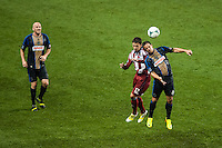 Marco Delgado (12) of CD Chivas USA goes up for a header with Daniel Cruz (44) of the Philadelphia Union. The Philadelphia Union defeated the CD Chivas USA 3-1 during a Major League Soccer (MLS) match at PPL Park in Chester, PA, on July 12, 2013.