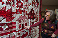 NWA Democrat-Gazette/ANTHONY REYES @NWATONYR<br /> Barbara Hamernik talks Monday, April 3, 2017 about her quilt &quot;Farm Girl Goes Red and White&quot; at the Shiloh Museum in Springdale. The quilt won Judge's Choice and First Place Pieced, Twin/Full Size Category in the Tomorrow's Heirlooms XVI quilt show.