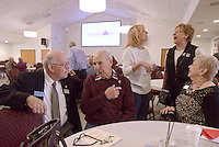 NWA Democrat-Gazette/BEN GOFF @NWABENGOFF<br /> Marland Thurston (from left) of Bentonville, Walter Fairbrother of Sherman, Texas, Patty Hagar of Skiatook, Okla., Nona Sperry of Bella Vista and Helen Weeks of Bella Vista chat in the new fellowship hall on Sunday Nov. 8, 2015 after service at Bella Vista Lutheran Church. The church held a dedication ceremony Sunday for their recently completed 10,500 square foot expansion, which includes the new fellowship hall upstairs and classroom space downstairs. The project also involved the renovation of 6,500 square feet of existing space, making more room for offices and the church's food pantry.