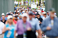 Fans cross the bridge over the turnpike during the 2016 U.S. Open in Oakmont, Pennsylvania on June 16, 2016. (Photo by Jared Wickerham / DKPS)