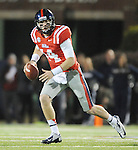 Mississippi quarterback Bo Wallace (14) runs against Mississippi State at Vaught Hemingway Stadium in Oxford, Miss. on Saturday, November 24, 2012. (AP Photo/Oxford Eagle, Bruce Newman).