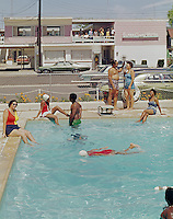 Elfra Court Motel, Wildwood NJ. Families swimming and lounging by the pool - 1967