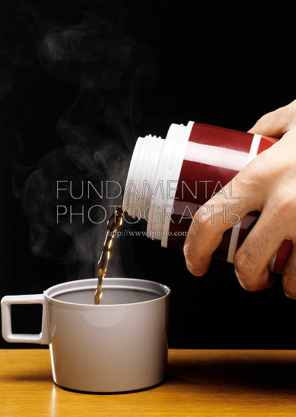 THERMAL INSULATION -POURING COFFEE FROM THERMOS<br /> Steam is Visible<br /> Due to insulating material in the thermos, hot liquids can be stored for lengthy periods of time.