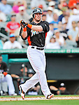 13 March 2012: Miami Marlins outfielder Scott Cousins in action during a Spring Training game against the Atlanta Braves at Roger Dean Stadium in Jupiter, Florida. The two teams battled to a 2-2 tie playing 10 innings of Grapefruit League action. Mandatory Credit: Ed Wolfstein Photo