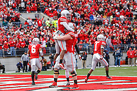 Ohio State Buckeyes wide receiver Philly Brown (10) celebrates with teammates after diving for a touchdown during Saturday's game in Columbus, Ohio on Saturday, Oct. 19, 2013. (Jabin Botsford / The Columbus Dispatch)