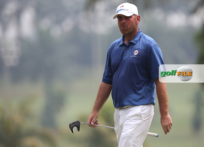 Team Europe's Thomas Bjorn (DEN) had a battle on his hands against Team Asia's Kiradech Aphibarnrat (THA)  during the final day of Singles matches at the 2014 EurAsia Cup presented by DRB-Hicom, at the Glenmarie Golf & Country Club, Kuala Lumpur, Malaysia. Picture:  David Lloyd / www.golffile.ie