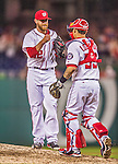 20 May 2014: Washington Nationals pitcher Ryan Mattheus gets a fist bump from catcher Jose Lobaton after a game against the Cincinnati Reds at Nationals Park in Washington, DC. The Nationals defeated the Reds 9-4 to take the second game of their 3-game series. Mandatory Credit: Ed Wolfstein Photo *** RAW (NEF) Image File Available ***