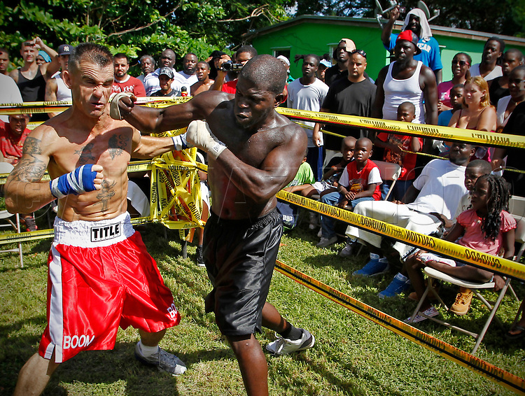"This is fighter John ""Boom Boom"" Andre at left, competing against Sylvester ""Fruidy Lou"" (cq) on September 18, 2010. Dhafir Harris, ""Dada 5000"", puts on backyard fights at his mother house, which go viral on youtube and have been the subject of documentaries. Sometimes the men fight until they are unconscious. There' s no gloves and occasionally, there's a cage. The community has taken to the events, because they are able to set up businesses selling food and washing cars."