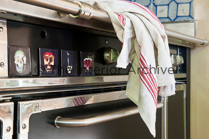 A red striped kitchen towel on the range cooker