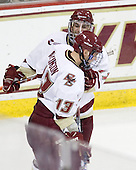 Brian Gibbons (BC - 17) and Cam Atkinson (BC - 13) celebrate Atkinson's goal. - The Boston College Eagles defeated the visiting Merrimack College Warriors 3-2 on Friday, October 29, 2010, at Conte Forum in Chestnut Hill, Massachusetts.