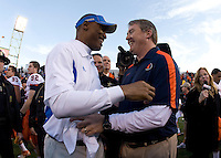 Illinois head coach Vic Koenning shakes hands with UCLA head coach Mike Johnson after the game during Kraft Bowl at AT&T Park in San Francisco, California on December 31st, 2011.   Illinois defeated UCLA, 20-14.