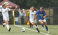 Boston College midfielder Coco Woeltz (2) and Duke University forward Laura Weinberg (16) battle for the ball. Boston College forward Rachel Davitt (24).Boston College (white) defeated Duke University (blue/white), 4-1, at Newton Campus Field, on October 6, 2013.