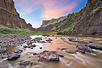 Idaho. South Fork Owyhee River.  Sunset with motion blur river in foreground.