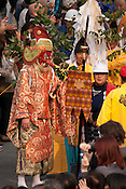 A demon (man in the red mask) in the procession of the Tagata Fertility Festival arriving at the shrine.
