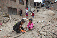 Nepal, Bungamati village that was basically destroyed by earthquake damage. Children play contstruction clean up.