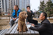 A former farmer entertains his dog in a &quot;replacement housing block&quot; in Beijing, built for people like him who has lost their farmland to a new phase of state-driven urbanisation. <br /> <br /> For generations, Chinese farmers picked vegetables on family plots in China, a mainly agrarian society right up until the 20th century.<br /> <br />  <br /> <br /> Faced with slowing exports, Communist leaders are pushing ahead with a historic plan to move 100 million rural residents into towns and cities by 2020 to create a new middle class and boost demand.<br /> <br />  <br /> <br /> As a non-resident Chinese, Justin views the situation both as a concerned citizen and a questioning outsider. As he crisscrosses the country talking with farmers, he gets a feeling the government&rsquo;s maths might be right, but wonders at the long-term consequences for society.<br /> <br />  <br /> <br /> What happens to humanity -- and the earth -- when millions of subsistence farmers clamor to join the consumptive middle class in half a decade?<br /> <br />  <br /> <br /> This series for Sony is shot in Hebei province, just outside Beijing, as part of his bigger project.